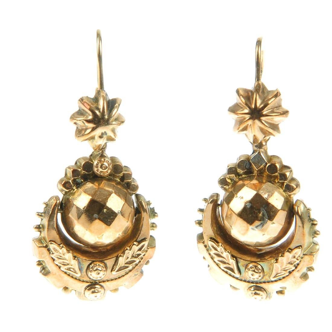 A pair of earrings. Designed as floral motifs, with