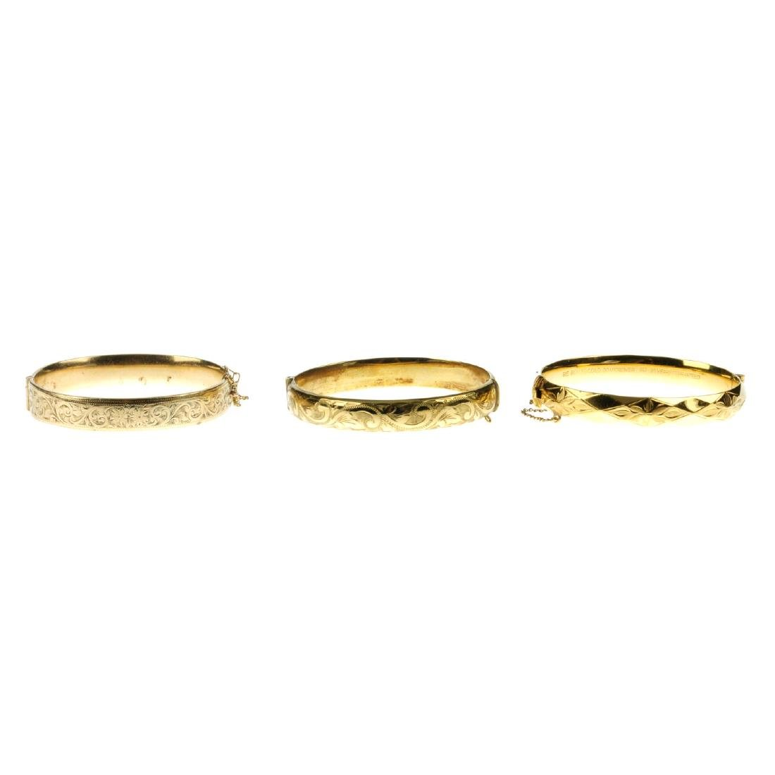 Eight mainly rolled gold bangles. To include one with