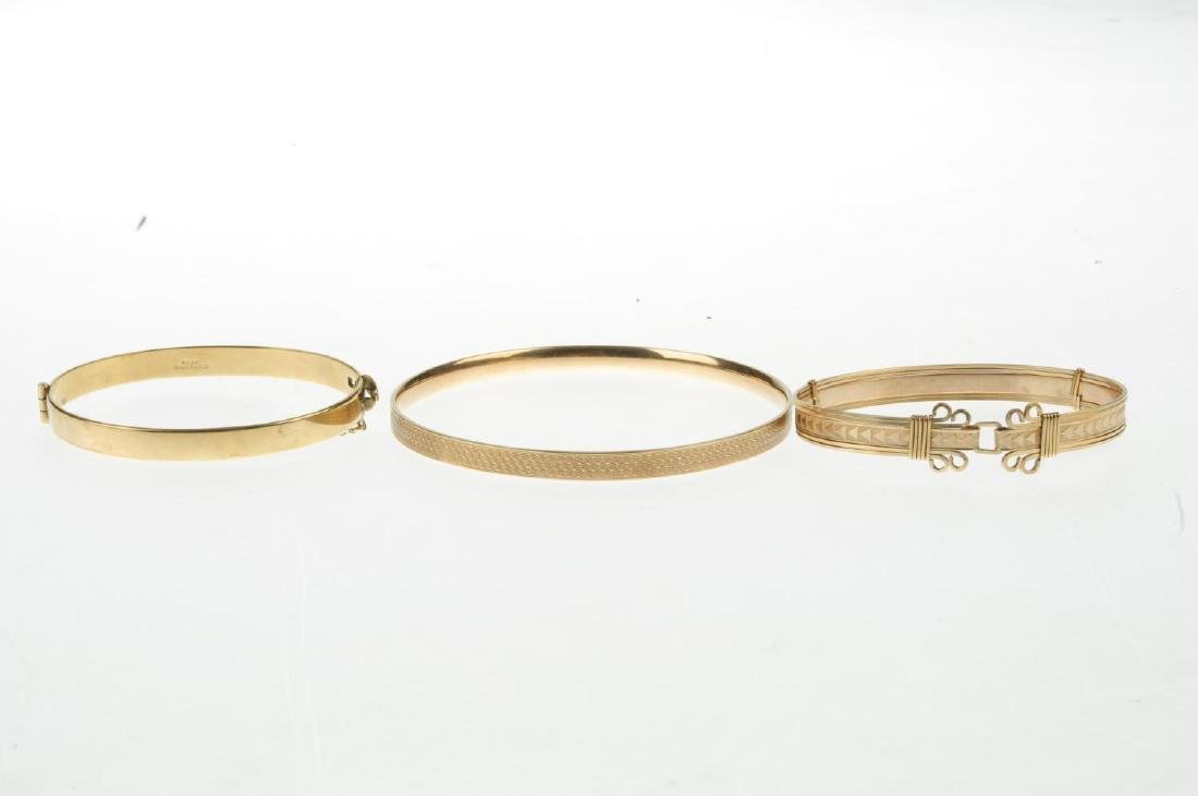 Eight mainly rolled gold bangles. To include one with - 3