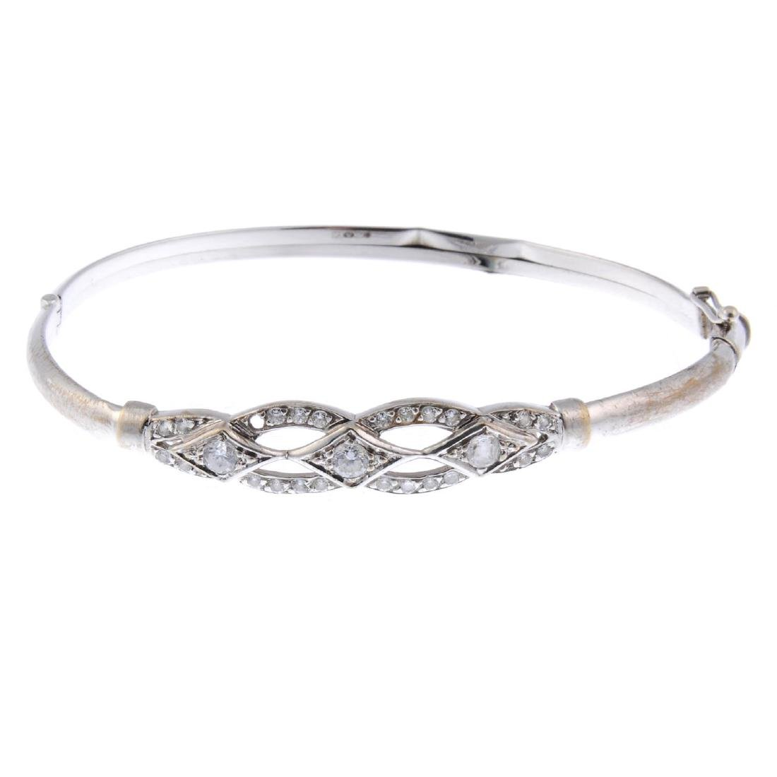 A bangle and a bracelet. The 9ct gold bangle with