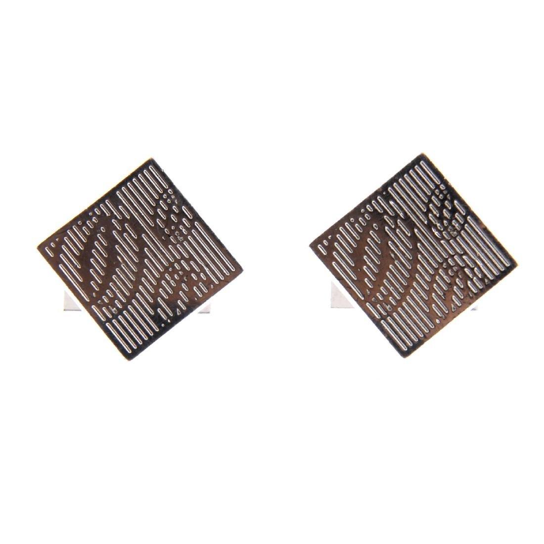 CARTIER - a pair of cufflinks. Each designed as a