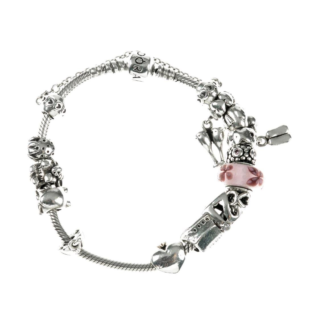 PANDORA - a charm bracelet with charms. The snake chain