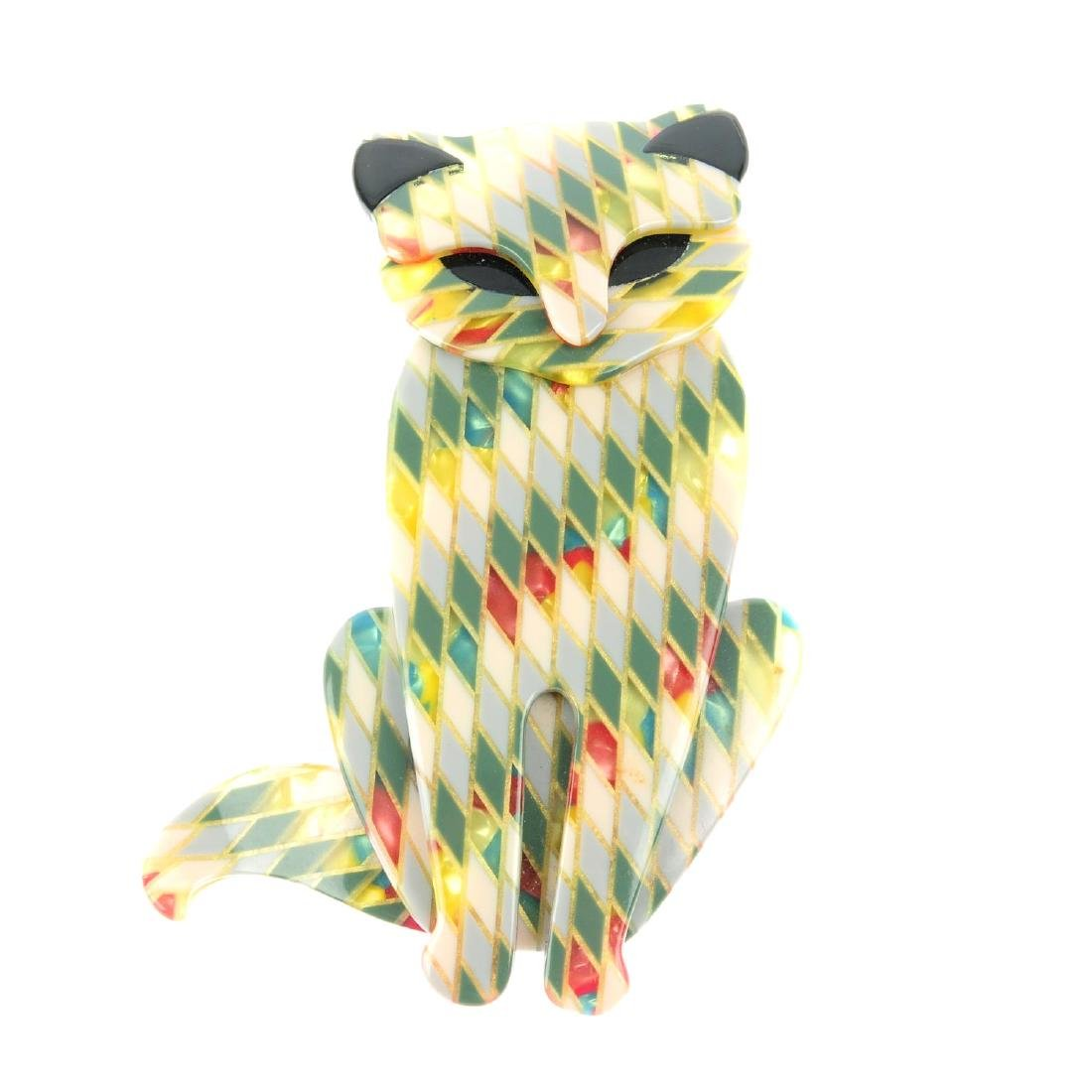 LEA STEIN - a cat brooch. The layered cat-shape brooch,