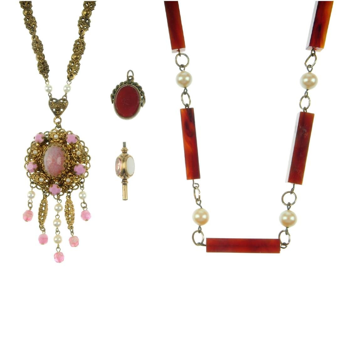 A selection of jewellery. To include mid 20th century