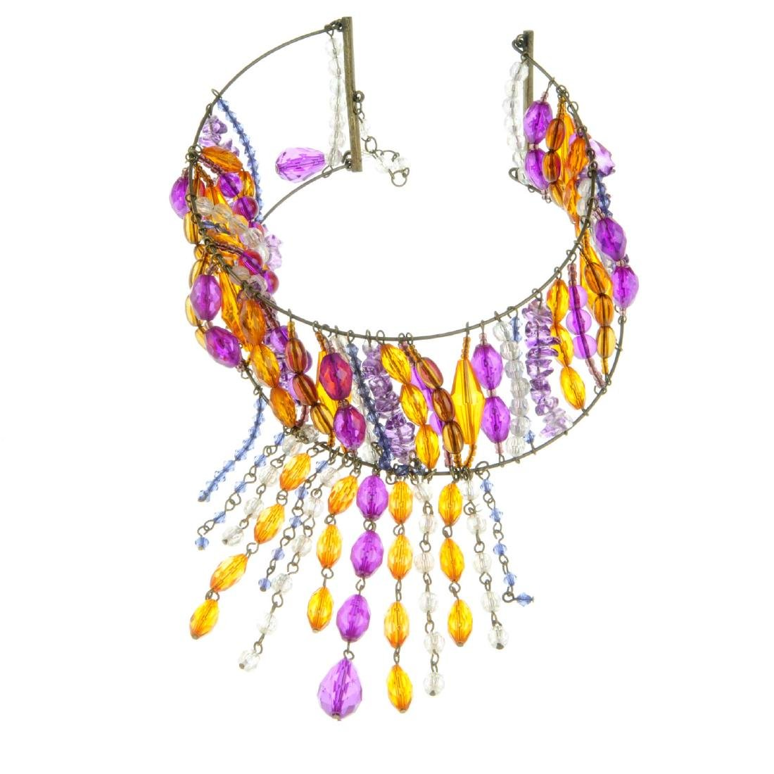 A bag containing a quantity of costume jewellery. To