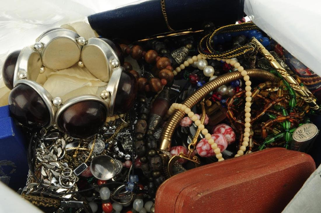 A bag containing a quantity of costume jewellery. To - 2