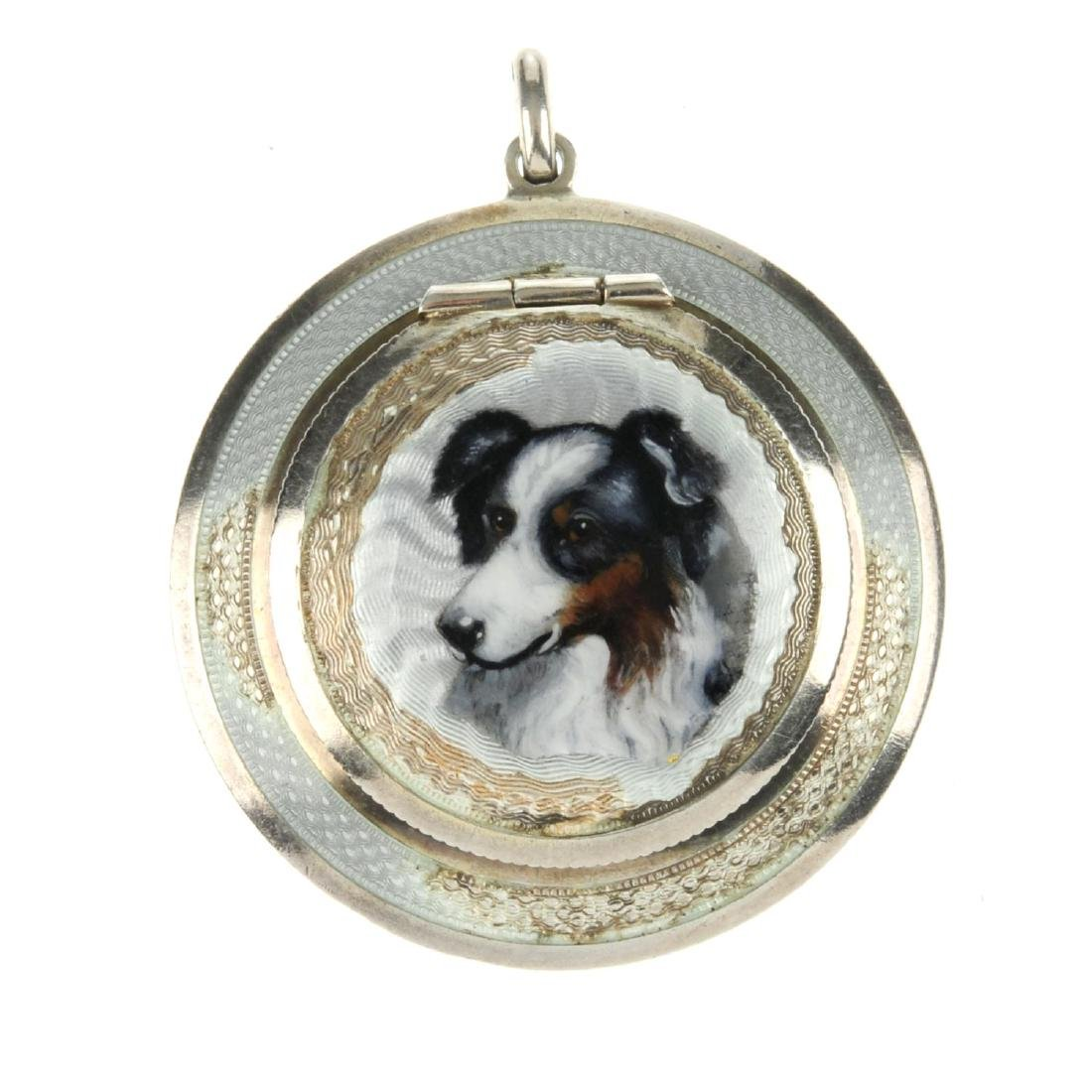 An early 20th century guilloche enamel compact pendant.