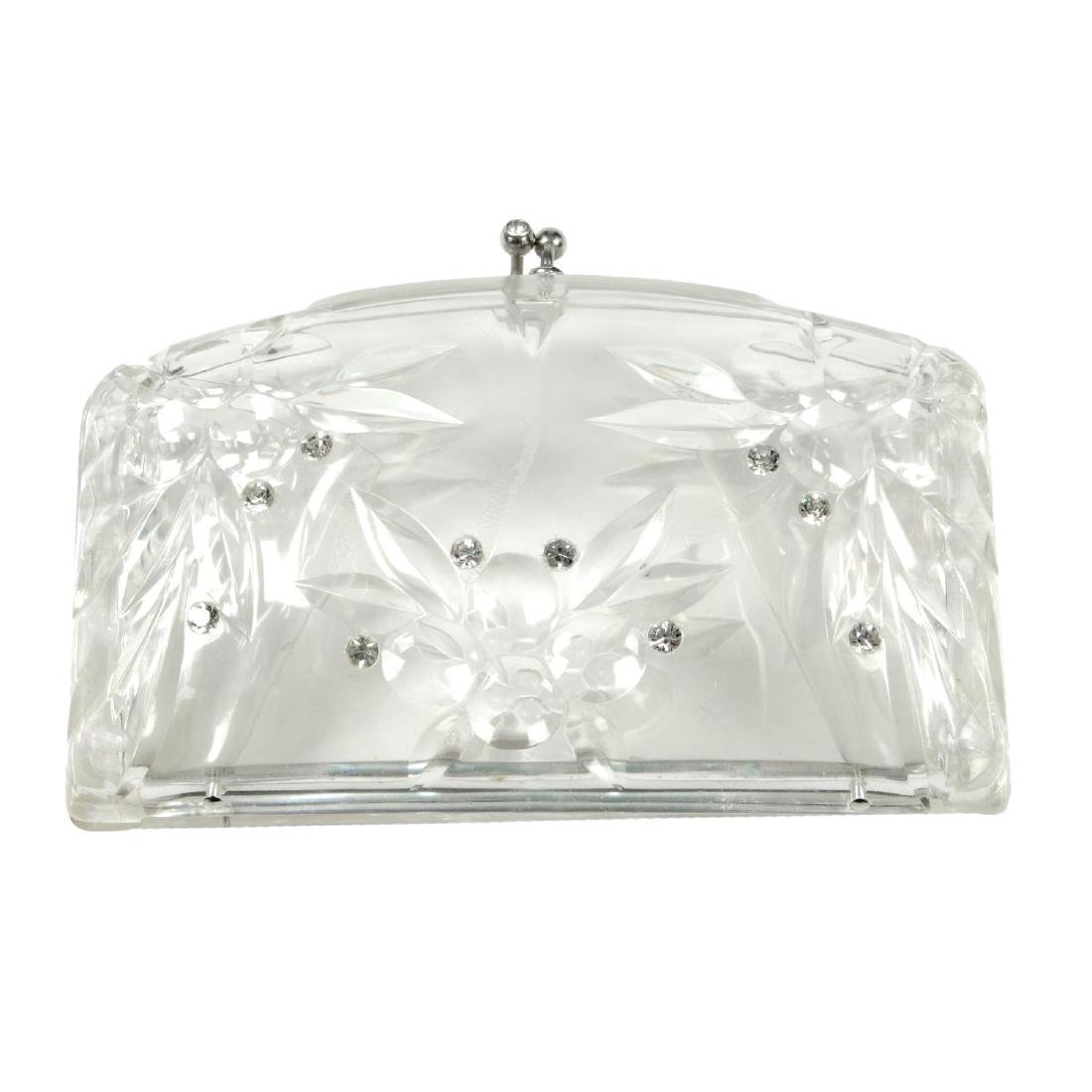 A clear lucite clutch handbag. Designed as a hinged