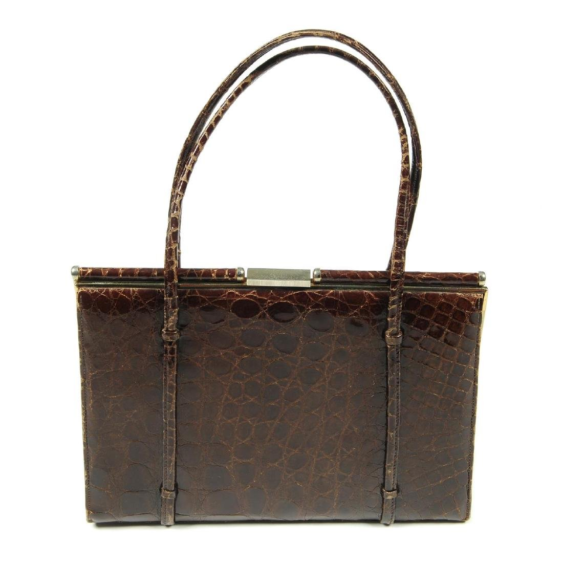 A vintage crocodile handbag and an enamel compact. To