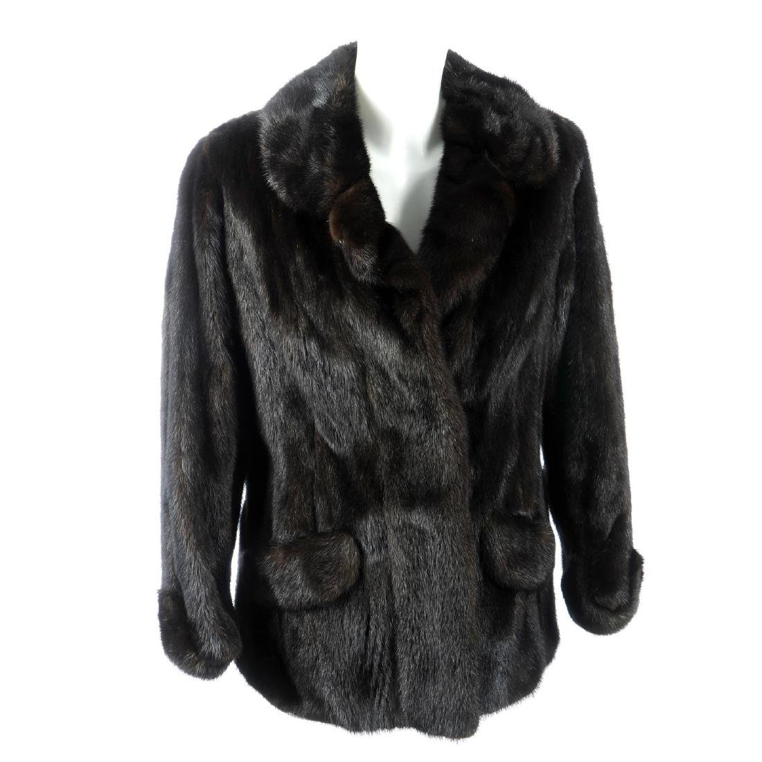 A dark ranch mink jacket. Featuring a notched lapel