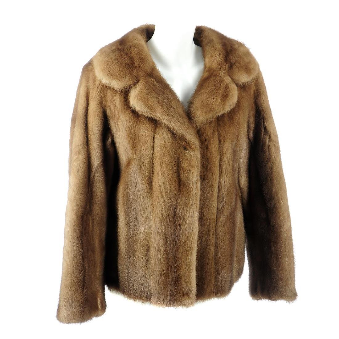 A demi buff mink jacket. Featuring a notched lapel
