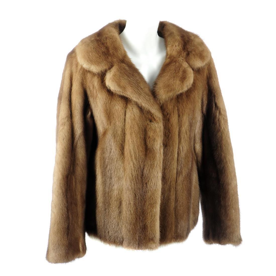 A demi buff mink jacket. Featuring a notched lapel