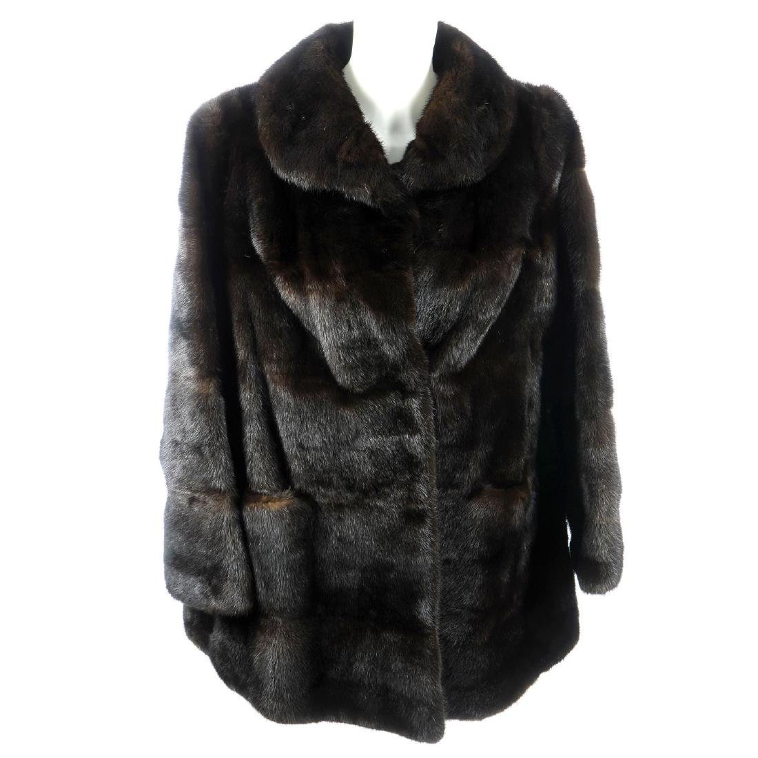 A ranch mink jacket. Featuring a lapel collar, hook and