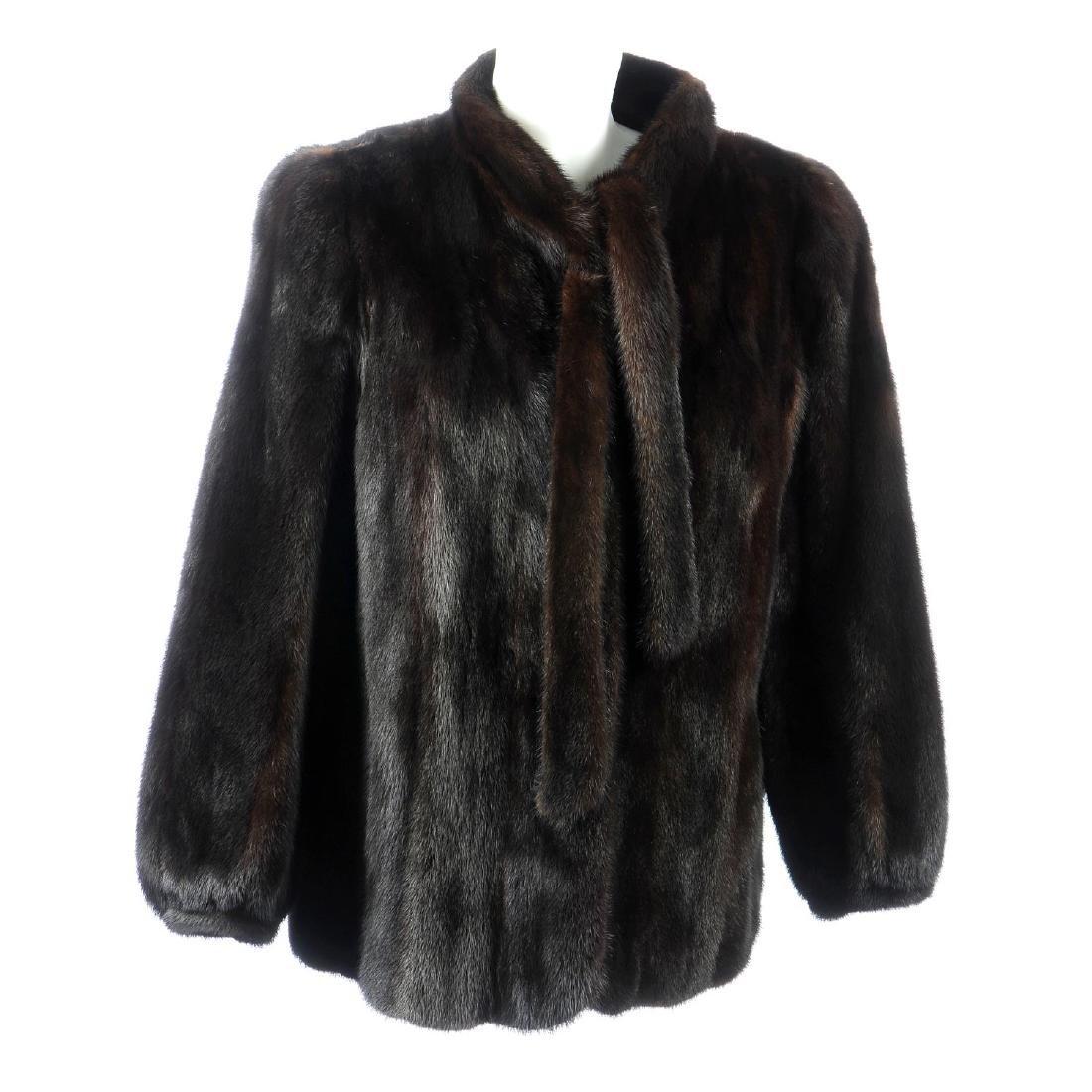 A dark ranch mink fur jacket. Featuring a Mandarin