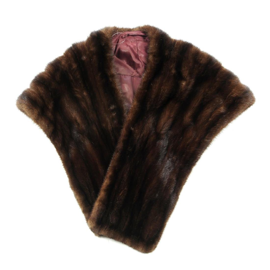 A ranch mink stole. Featuring a collarless design with