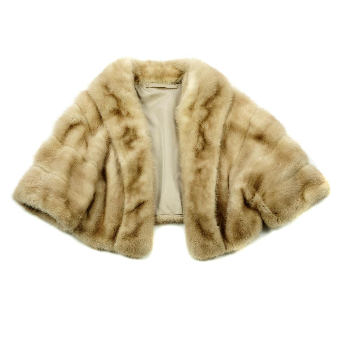 A palomino mink bolero. Featuring a shawl collar, an