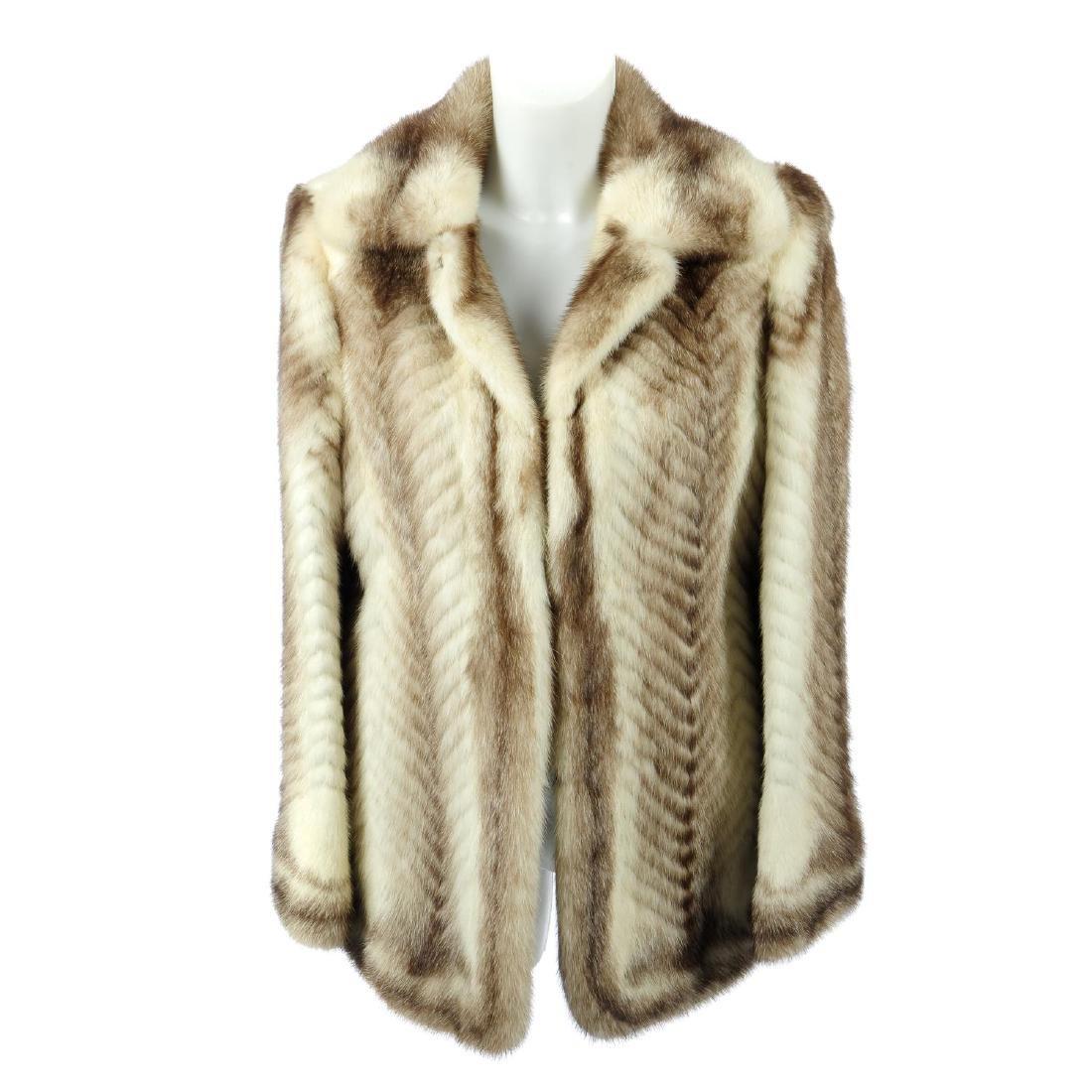 A chevron striped mink jacket. Featuring a pieced