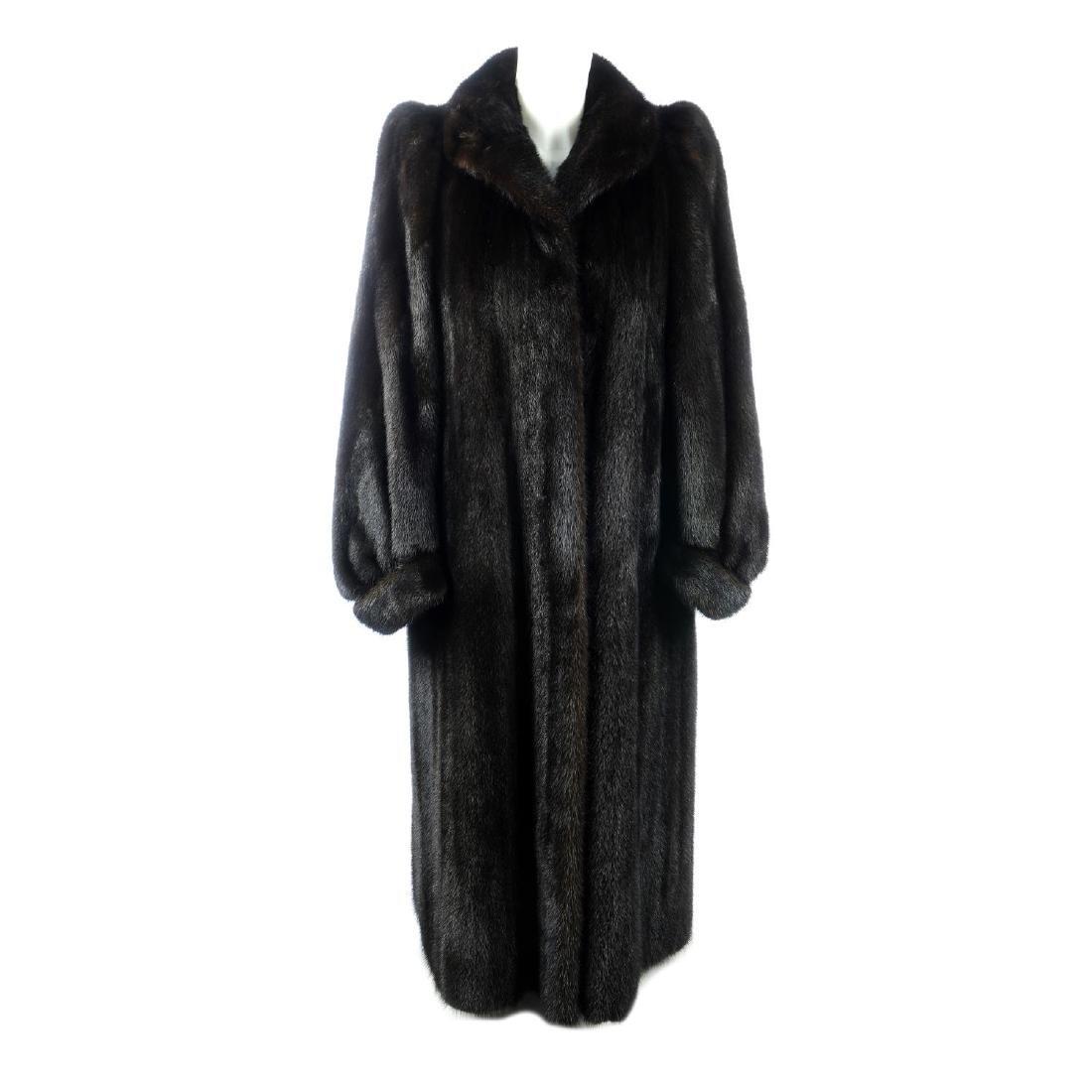 A dark ranch mink full-length coat. Featuring a lapel