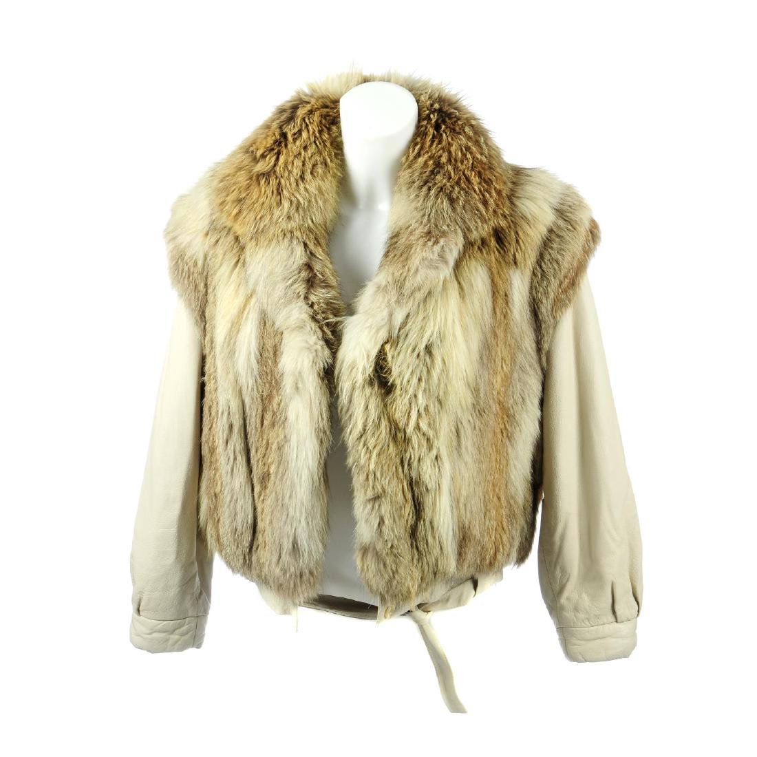 A wolf fur and leather jacket. Designed with wolf fur