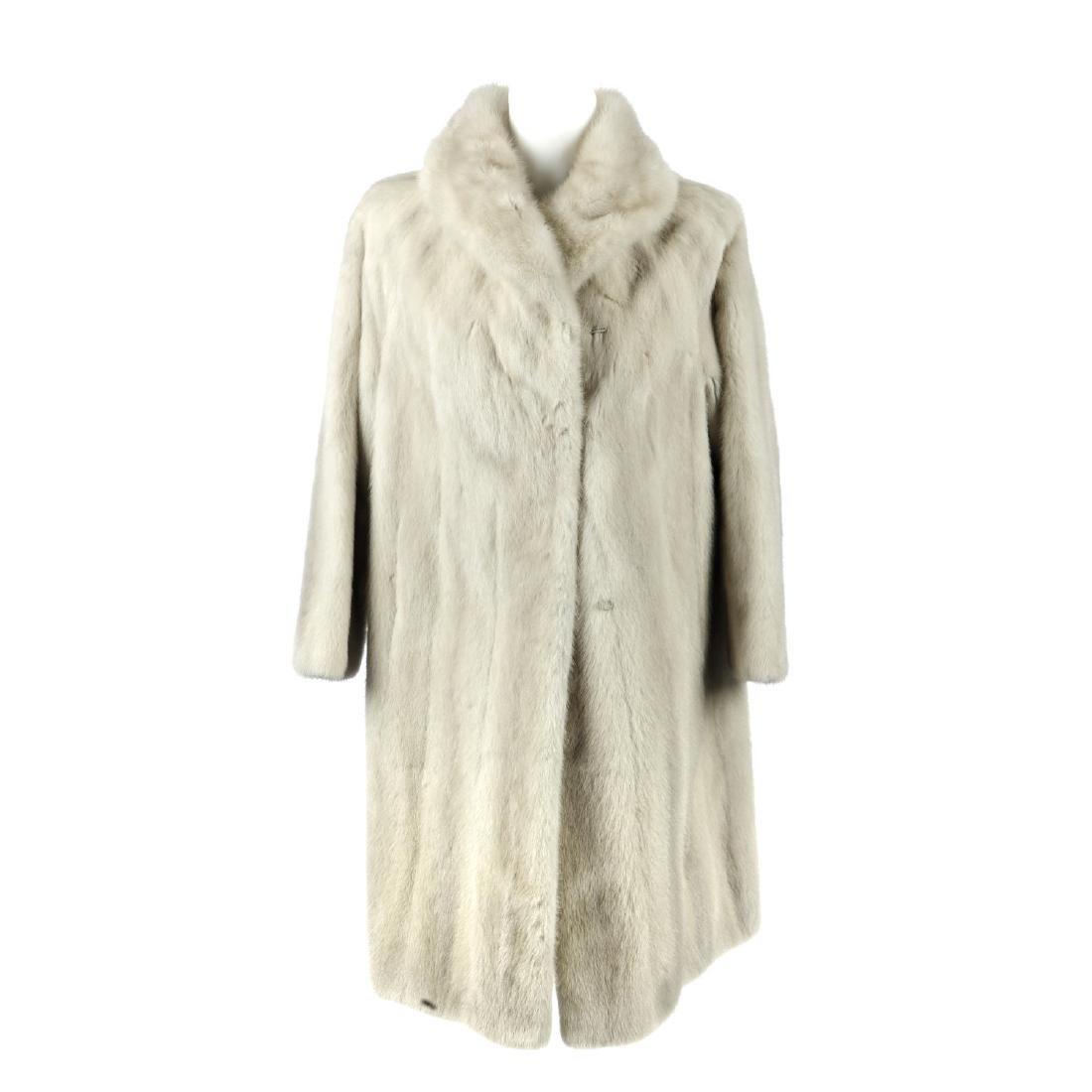 An azurene mink full-length coat. Featuring a shawl