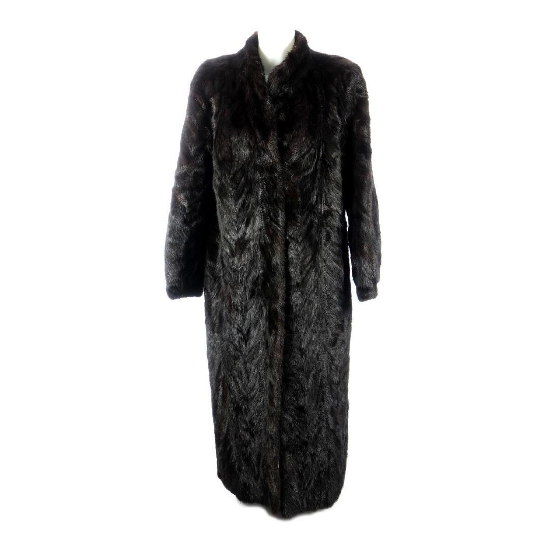 A pieced dark ranch mink full-length coat. Designed