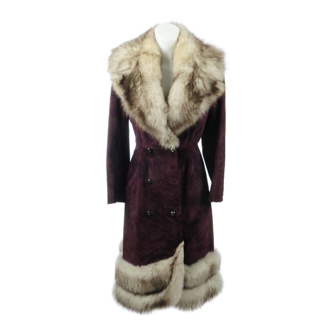 A purple suede full-length coat with fox fur trim.