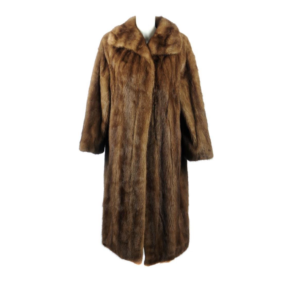 A full-length demi-buff mink coat. Designed with a