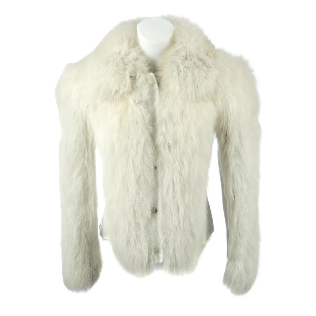 A leather jacket with fox fur panels. Designed with
