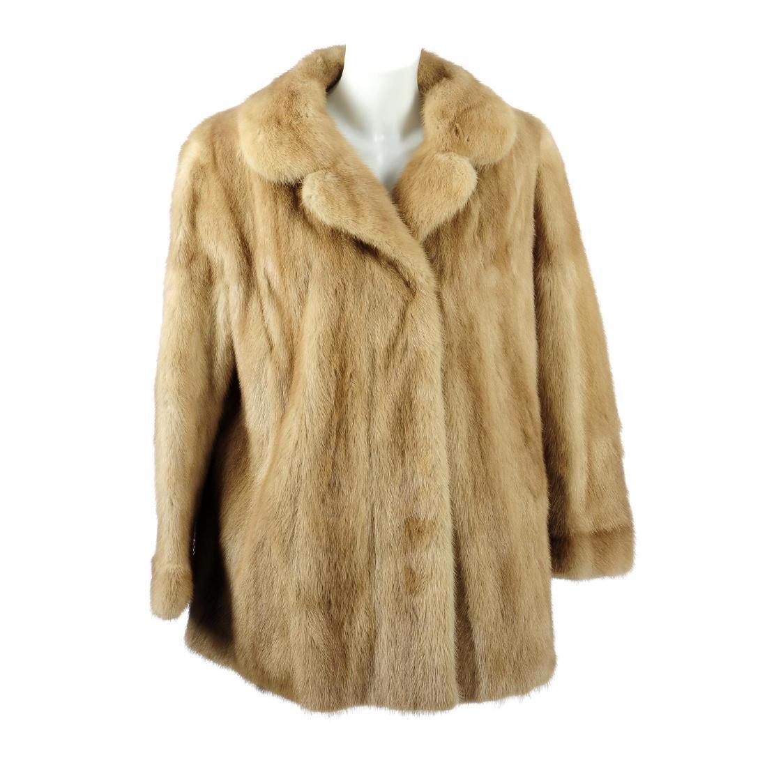 A three-quarter length palomino mink coat. Designed