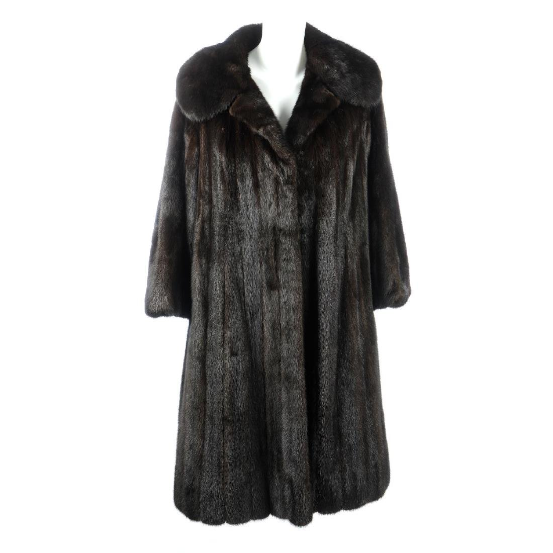 A dark ranch mink full-length coat. Featuring a notched