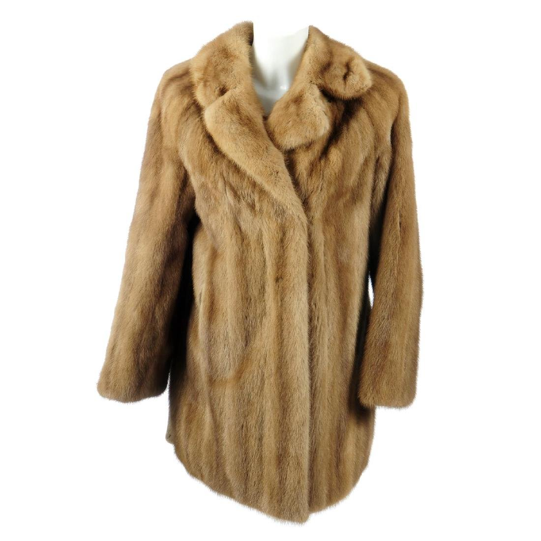 A palomino mink three-quarter length coat. Featuring a