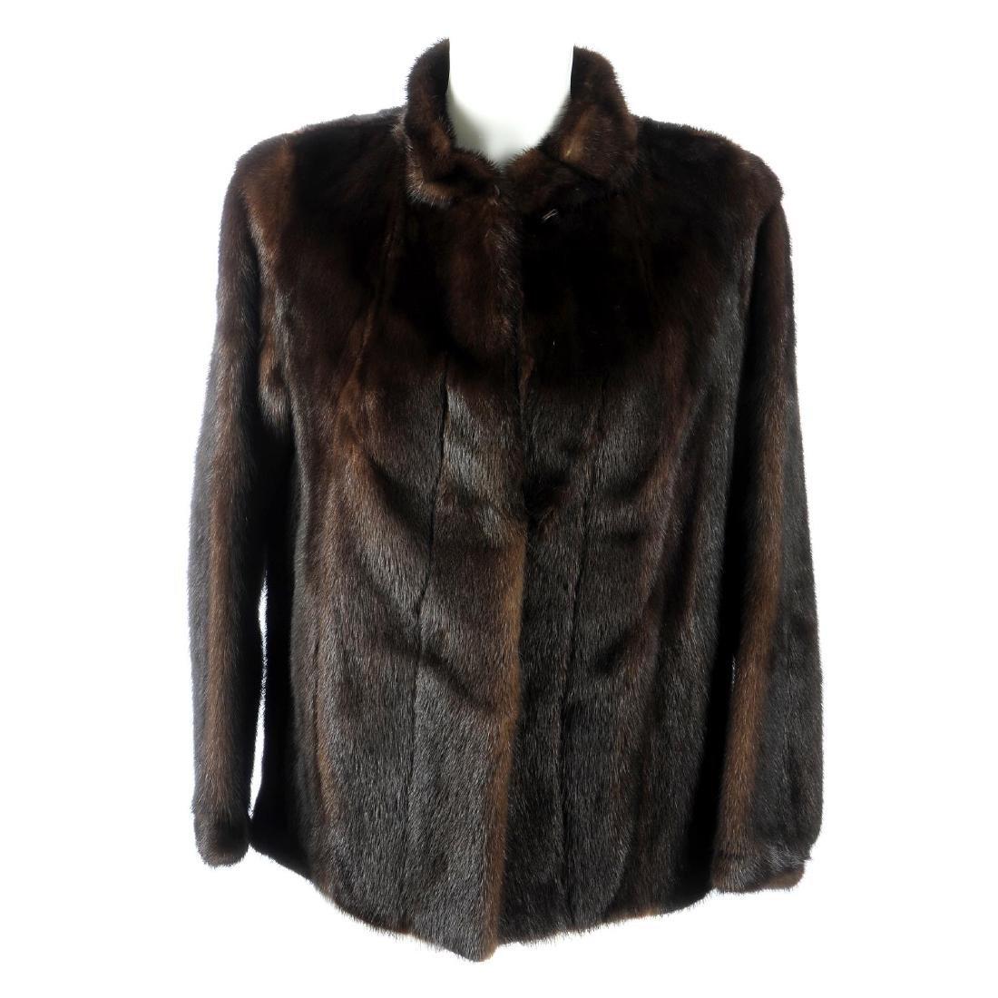 A dark ranch mink jacket. Designed with a short