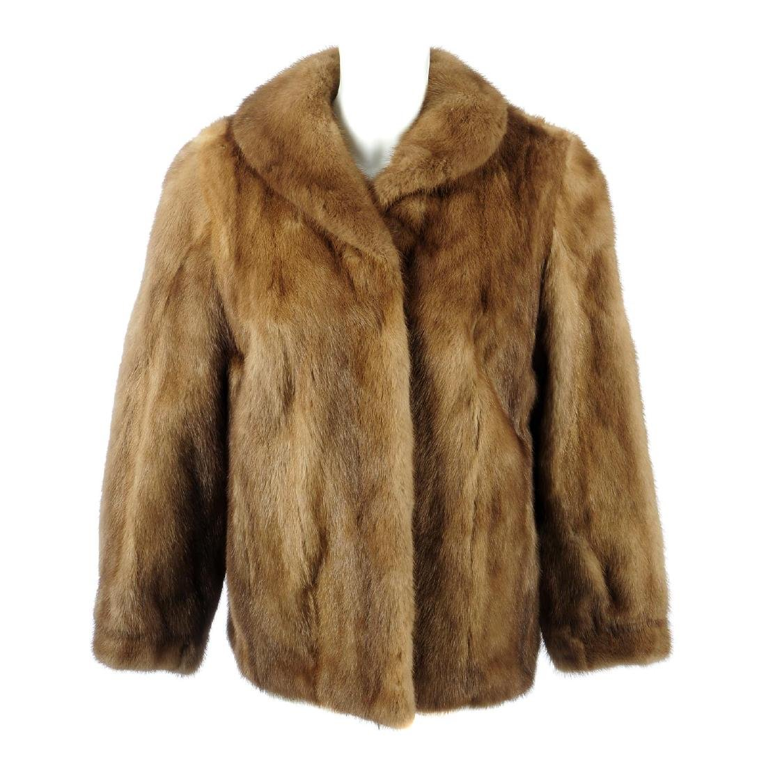 A pastel mink jacket. Designed with a lapel collar,