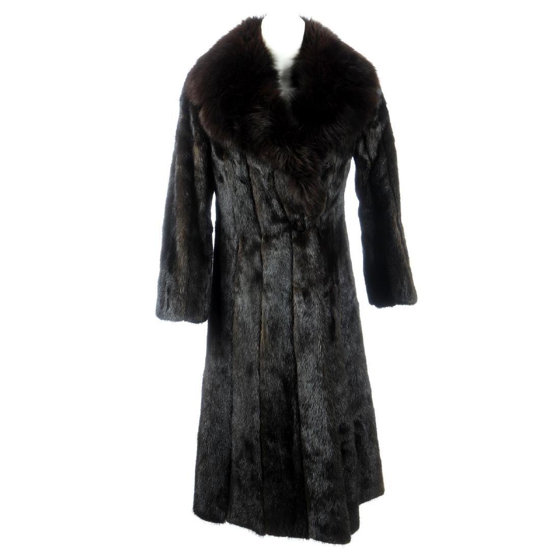 A dark ranch mink full-length coat with fox fur collar.