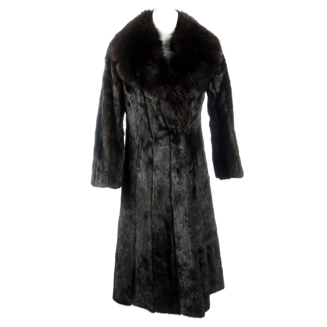 A dark ranch mink full-length coat with fox fur collar.