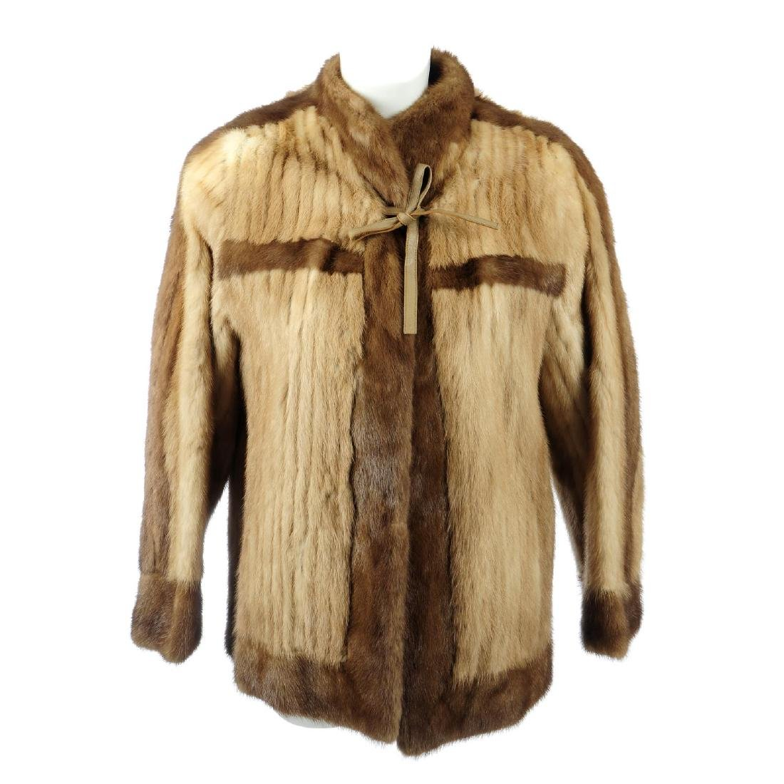 A pieced mink jacket. Crafted from pastel mink tails,