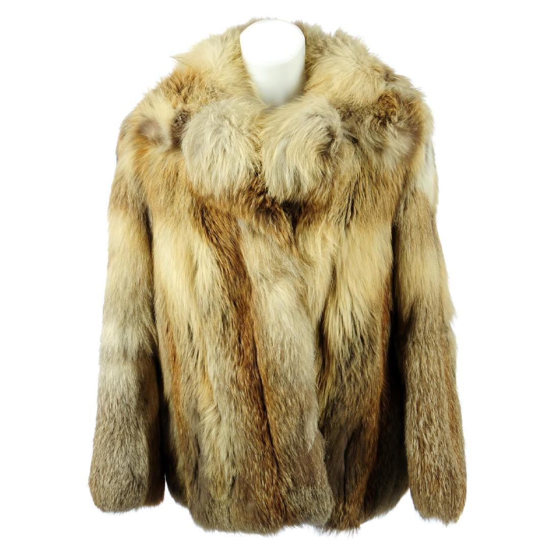 A red fox fur jacket. Designed with a notched lapel