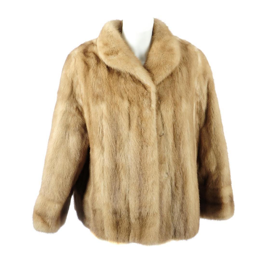 A pastel mink A-line jacket. Designed with a lapel