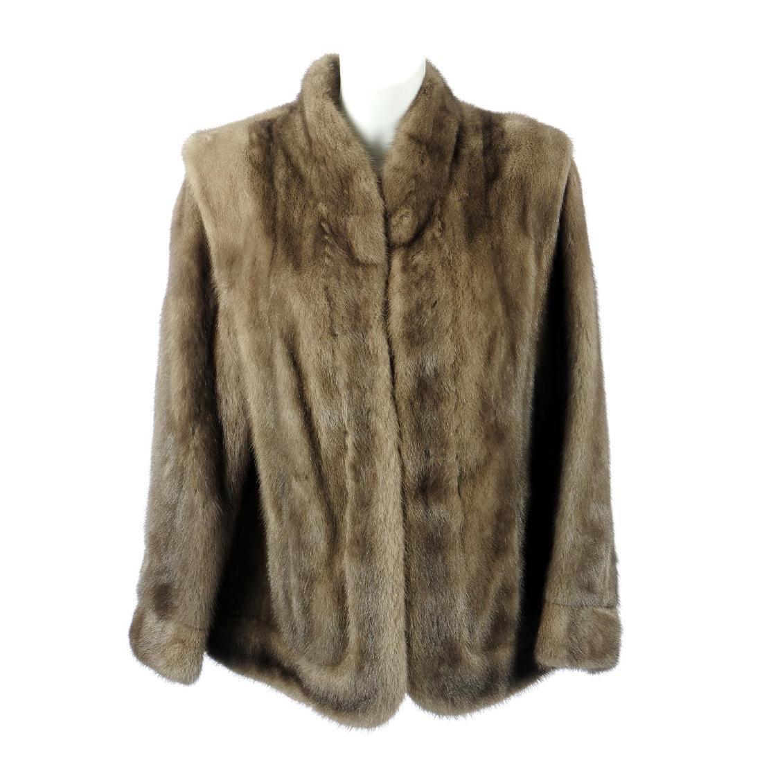 A sapphire mink jacket. Featuring a Mandarin collar,