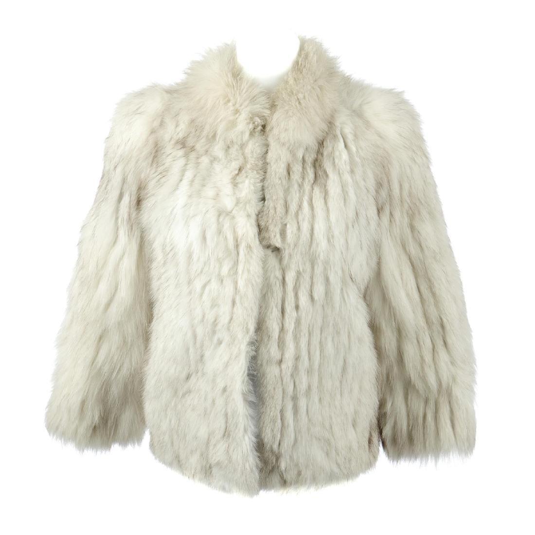 A pieced blue fox fur jacket. Designed with a short