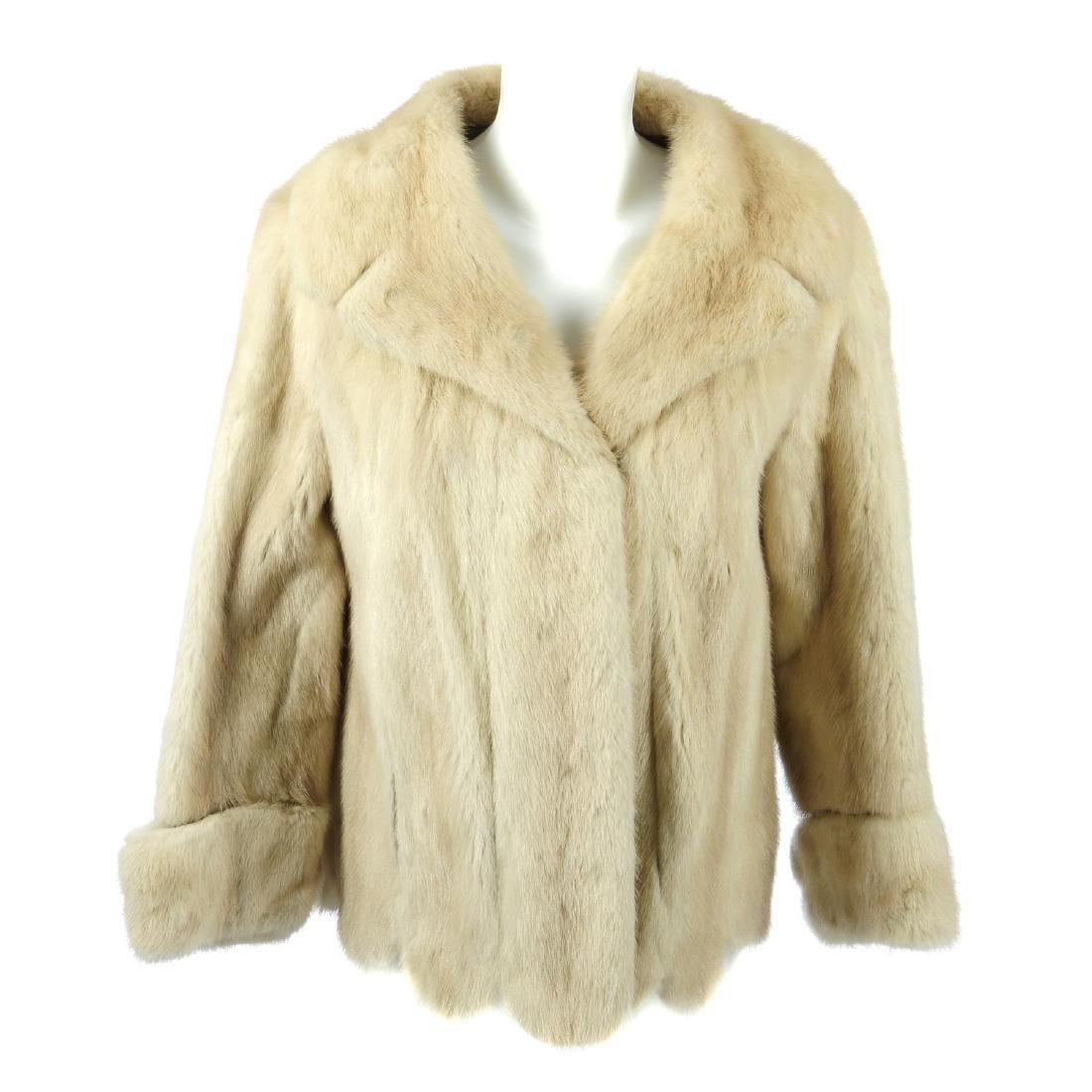 A tourmaline mink jacket with scalloped hem. Featuring