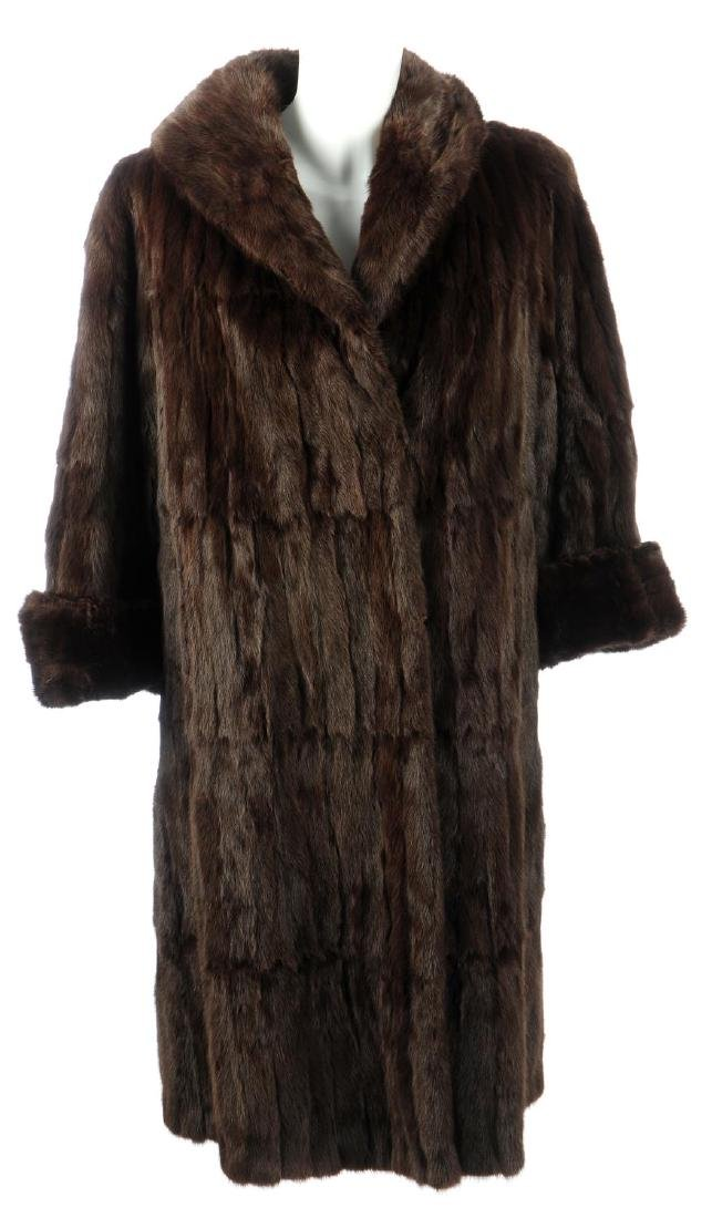 A Canadian squirrel fur coat and two fur stoles. The