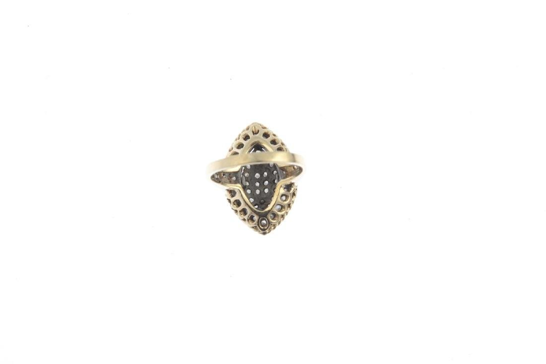 A 9ct gold diamond dress ring. Of marquise-shape - 2