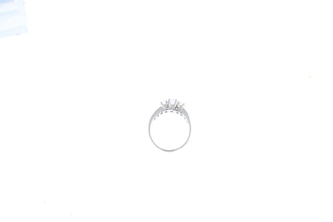 An 18ct gold diamond three-stone ring. The graduated - 2