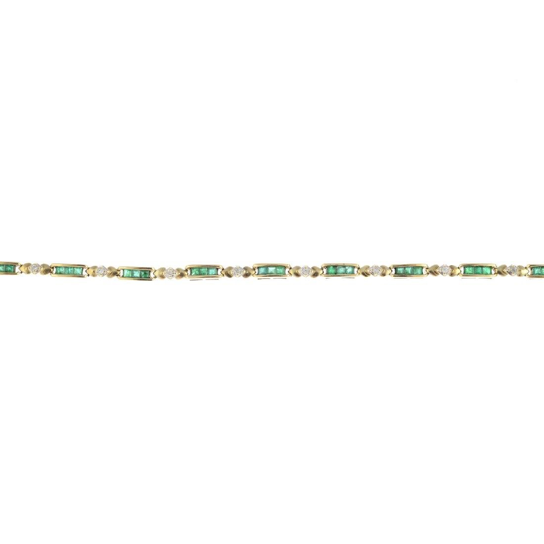 A 9ct gold emerald and diamond bracelet. Designed as a