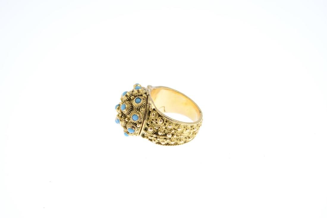 A reconstituted turquoise ring. The reconstituted - 2