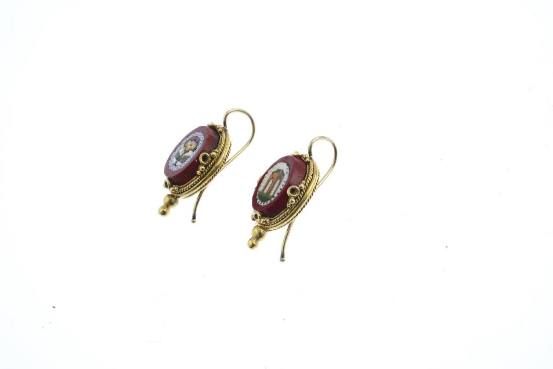 A pair of jasper and gem-set earrings. Each designed as - 2
