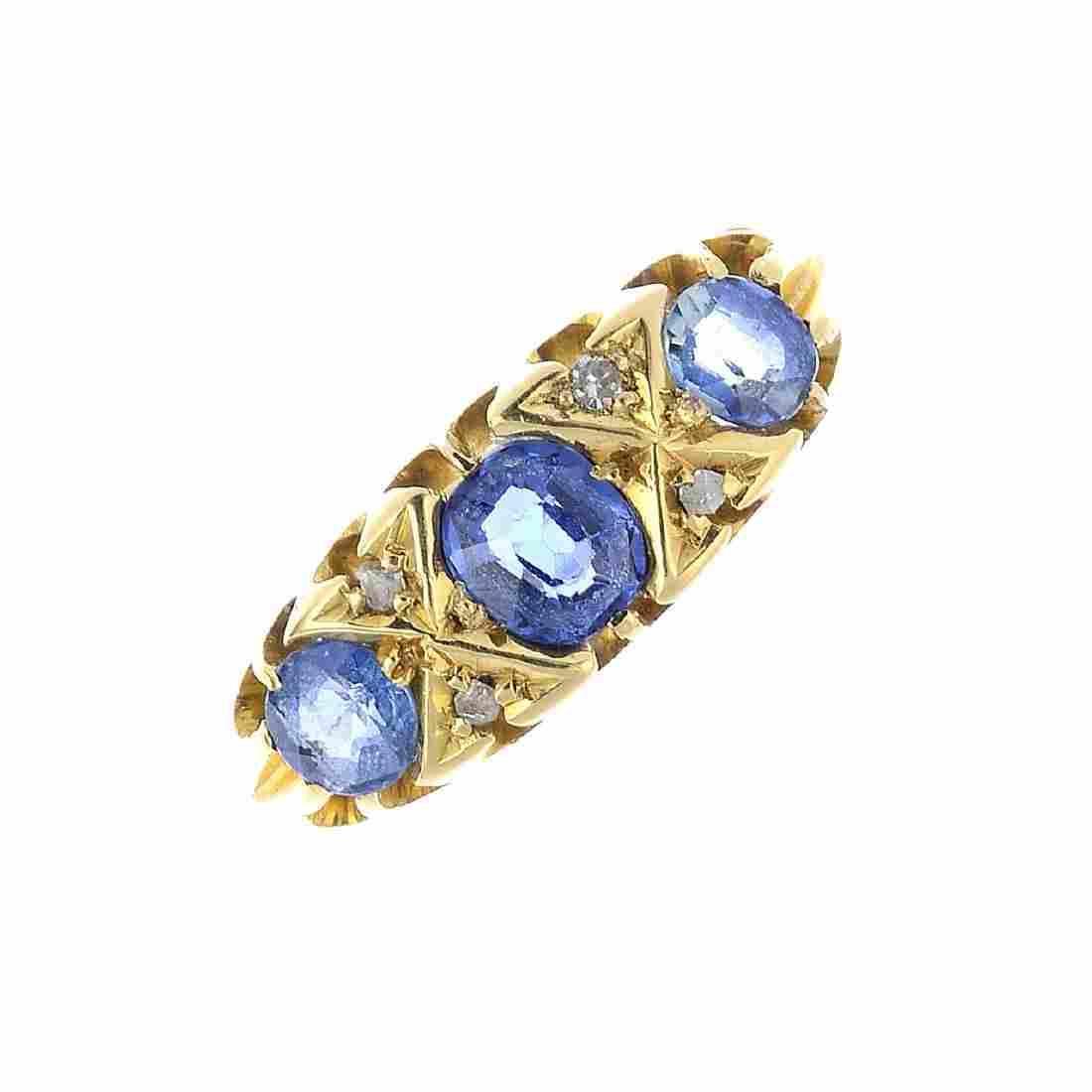 An Edwardian 18ct gold sapphire and diamond dress ring.