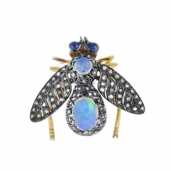 A gem-set bee brooch. Of openwork design, the oval and