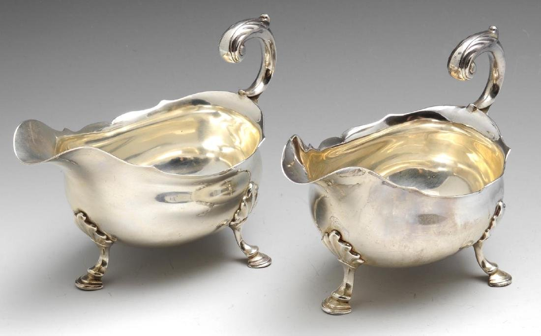 A pair of George II silver sauce boats, each of plain